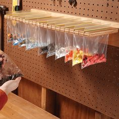 Keep screws, connectors, nails and other small parts in sight and handy with this resealable bag holder. You can build it out of a 3/4-in.-thick scrap of plywood. Start by cutting two pieces of plywood as shown. Draw lines 1 in. apart across the shorter piece with a square, stopping 1 in. from the edge. Now cut along the lines with a jigsaw. Screw the two pieces of plywood together and screw the unit to the wall. Fill resealable bags and slip them into the slots. Get more workshop storage…