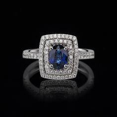 SAPPHIRE RING WITH A DOUBLE HALO