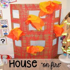 """House on """"fire"""" at the Fire Station dramatic play! It's so much for a fire safety theme or community helpers theme. Fire Safety Crafts, Fire Safety Week, Preschool Fire Safety, Fireman Crafts, Community Helpers Activities, Fire Prevention Week, Dramatic Play Centers, Preschool Activities, Nursery Activities"""