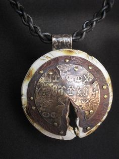 Ancient Shield by Richard Salley; braided leather, etched metal