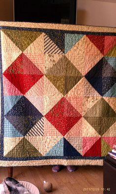 Half square triangle quilt with bolder colors