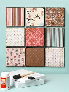 Oh my goodness! Love this idea.  I think this image is of Basic Grey scrapbook paper (Blush line).  Styrofoam 12 by 12 boards mounted to wall w/ great paper!  And, a friend of mine did something like this and uses it to mount pictures.  Cheap and friendly wall decor!    Do this plus solid paper with catch phrases that inspire.