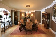 Beautiful crown molding and dark paint color in this dining room! #diningrooms homechanneltv.com