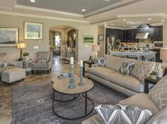 Transitional Living Room with Crown molding, Carpet, limestone tile floors