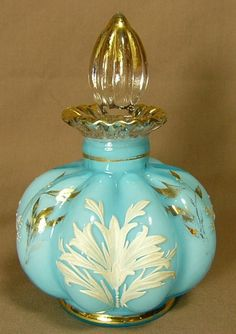 Fenton Glass Blue Melon Rib Perfume Bottle with Gold White Leaves and Trim.