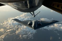 A B-2 Spirit flies into position during a refueling mission over the North Atlantic Ocean June 11, 2014. The B-2 is conducting training flights and regional familiarization in the U.S. European Command area of operations. The B-2 is a multi-role bomber capable of delivering both conventional and nuclear munitions. (U.S. Air Force photo by Tech. Sgt. Paul Villanueva II/Released)