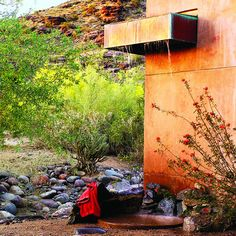 Irresistible outdoor shower designs  2. Desert simplicity    A copper canopy and cast-earth side wall form an oasis at Anne Schneider's Phoenix home.    Design: Woolsey Studio, Tempe, Ariz.,