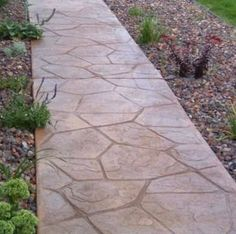 Concrete has so much more to offer now than it did in the past. These days, it can be colored and textured to look like many other types of stone or paving materials. This stamped concrete design has an undeniable warmth lacking in traditional floated concrete.