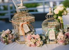 birdcages - I like how you could bring a bit of colour to the table with these, they have ribbons on them
