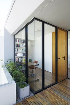 Glass walls (with curtains when used as guest room)
