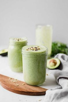 The Ultimate Green Avocado Smoothie! Made with avocado, banana, kale, almond milk, and protein powder (optional). Top with pistachios and cacao chips for a great way to start the day! This green avocado smoothie is vegan, vegetarian, gluten-free, and dairy-free. #healthy #avocadosmoothie #greensmoothie
