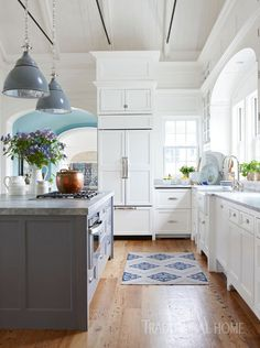 All the kitchen counters are topped with leathered white quartzite. The island's counter is a chunky two inches thick, double that of the perimeter counters, providing a subtle variation in style. - Photo: Michael Partenio / Design: Nancy Serafini
