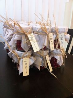 Mason jars filled with candy as engagement party favors.