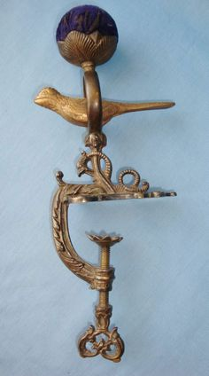 oh, if I had money. The things I would collect... Antique brass sewing bird with sea serpent clamp