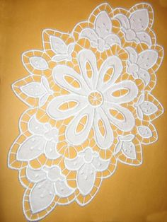 Advanced Embroidery Designs - Fleur de Lis Cutwork Doily.