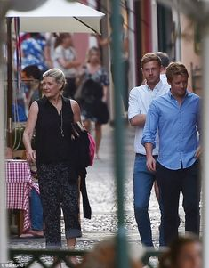 Hugh was pictured going for lunch with his mother and friends before enjoying a swim in th.
