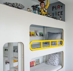 A triple bunk (the top one for playing) in A Play-Driven Bedroom for Three in Spain