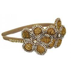 http://www.bekids.com.br/tiara-flores-dourada-roana.html