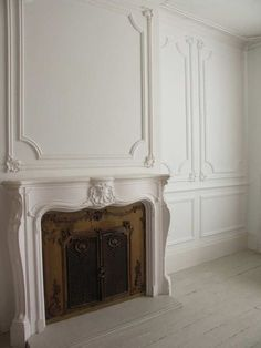 CocosCollections Absolutely beautiful fireplace and wall panels. Fireplace Wall, Fireplace Surrounds, Fireplace Design, Fireplace Mantles, Fireplaces, Fireplace Molding, Mantels, Bedroom Fireplace, French Walls