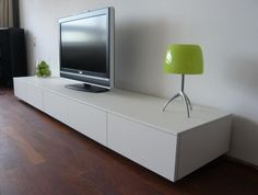 20 Collection of White Tv Cabinets White Tv Stands, Funky Tv Stands, White Tv, Furniture, Home, Simple Tv Stand, Wooden House Decoration, White Tv Cabinet, Tv Rack Design