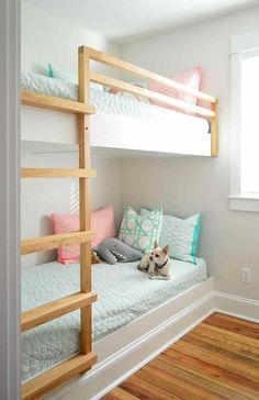 See how we made DIY built-in bunk beds, including a ladder and railing, by building simple floating platforms for two twin XL mattresses.