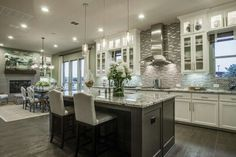 Love this kitchen and open concept floor plan! More