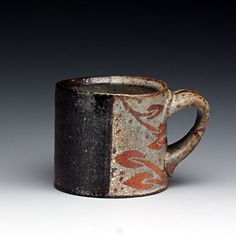Karin Solberg.  Love her mugs, they are absolutely beautiful arts.