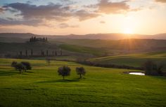 Val d'Orcia, Tuscany. #Belvedere #ValdOrcia #travel #Trees #Tuscany #Sunstar #sunlight #Sunrise #print #Sun #SunRays #Toscana #outdoorphotography #MorningSun #Morning #MorningLight #marcoromaniphotography #landscapephotography #Landmark #Hills #EarlyMorning #Clouds #Farms #Countryside #Fields #fineart #fineartphotography #Italy #Italia #Green #landscape #marcoromani #Podere #Nikon #Feisol #Nikkor #NikonD800