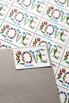 20c Floral Love Unused Vintage Postage Stamps -- Add an Ounce to 10 Wedding Invitations. $6.50, via Etsy.