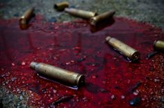 He hit the ground with a thud. He felt his body go numb from the blood loss. Noises echoed around him and in the distances he could hear someone shouting. Bullet cases hit the ground beside him. Blood ran through the cracks around him covering the bullet casings red. They began to bluer when he felt his body jerk upwards. Strong arms wrapped around him and that's when he blacked out.