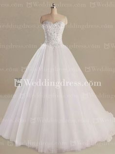 Perfect for the princess bride, this Tulle ball gown features the allover beading bodice.