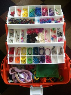 Organize the girl's hair ties in a tackle box!