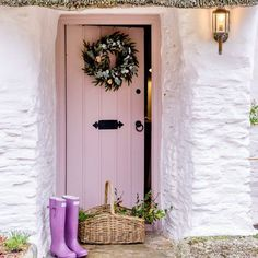 This thatched cottage in Cornwall, featured in Ideal Home Magazine, truly is a property of dreams. Just look at that pale pink door What would be your ideal home Door Decorations, Country Front Door, Pink Houses, Country Cottage Decor, Cottage Interiors, Pink Front Door, Thatched Cottage, Cottage Front Doors, Pink Interior