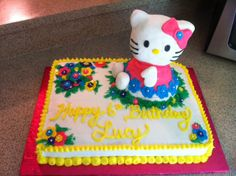 Hello Kitty Cake~ Kitty made of rice crispy treat covered in marshmallow fondant. Vanilla cake with buttercream frosting.