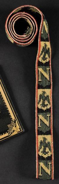 Galon brodé, de livrée ou de trompette. Au «N» et à «l'Aigle» impériale en alternance. Longueur: 80 cm. B.E. Epoque Premier Empire