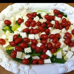 """Caprese salad for a crowd! I made this up for a dinner party: A bag of Romaine, a bag of spinach, cubed fresh mozzarella, grape tomatoes, and basil cut """"chiffonade"""" (in thin ribbons).  This will be tossed with a homemade balsamic vinaigrette.  Lovely! - Carolyn"""