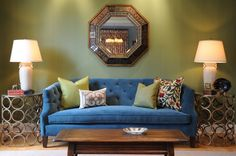 Living room with green wallpaper and blue sofa
