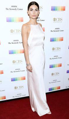 Lily Aldridge in a simple white high-neck halter dress