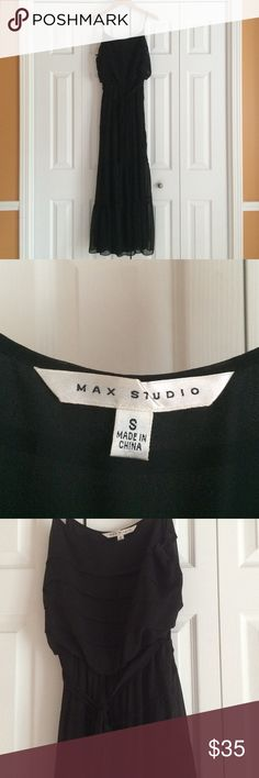 Max Studio Maxi dress Black Max Studio maxi dress size small. This dress is NWOT, it's never been worn! Has a middle tie which can be removed if you so choose (please see picture). Very lightweight, fully lined. Appears to have layering down the whole dress, but that's the detail, was difficult to capture in pictures (see last picture) Max Studio Dresses Maxi