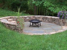fieldstone seat wall with stone slab steps and bluestone patio