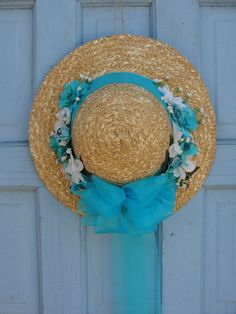 Spring Wreath, Straw hat wreath, Wreath, Spring , Blue Sky Straw hat Wreath, Blue Sky Straw hat, Spring Wreaths, Blue Hat, Sun Hat by Thecrafterwithinme on Etsy Spring Wreaths, Summer Wreath, Hat Crafts, Decor Crafts, Lilac Flowers, Dried Flowers, Flip Flop Wreaths, Hat Decoration, Spring Hats