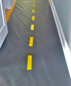 Hallway converted to a road for a construction themed birthday party - super easy w/craft paper & yellow duct tape