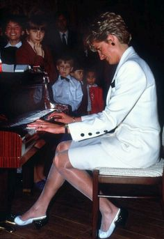 May 9, 1991:  Princess Diana plays the piano to patients at the House of Children Orphanage inside Hradcany Castle in Prague, Czechoslovakia.