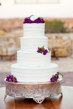 Wedding Cake: Love the deep purple color scheme. Yum!