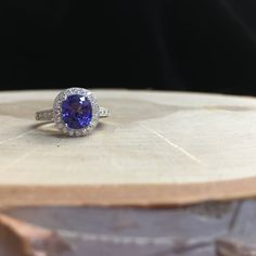 Gorgeous 14k white gold tanzanite and diamond ring  •shop this ring, link in bio• .