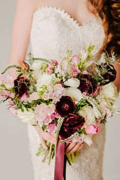 romantic blush and wine bouquet by Damsel Floral featuring ranunculus, veronica, tulips, roses, protea and campsis