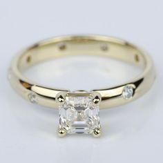 A stunning Asscher Cut Inset Diamond Engagement Ring in Yellow Gold!