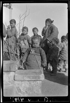 """Children staring at camera """"What You Doing"""".  Hand written note on the image by Photographer Sidney D. Gamble of the Procter and Gamble family.  China 1917."""