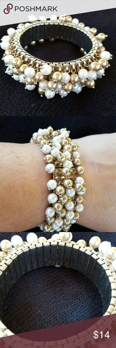 Beautiful Beaded Bracelet Pearl and champagne colored beades  Expandable band, all beads in tact Will fit most wrists Excellent condition Jewelry Bracelets