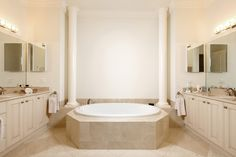 Master bath with dual sinks, separate tub and shower.